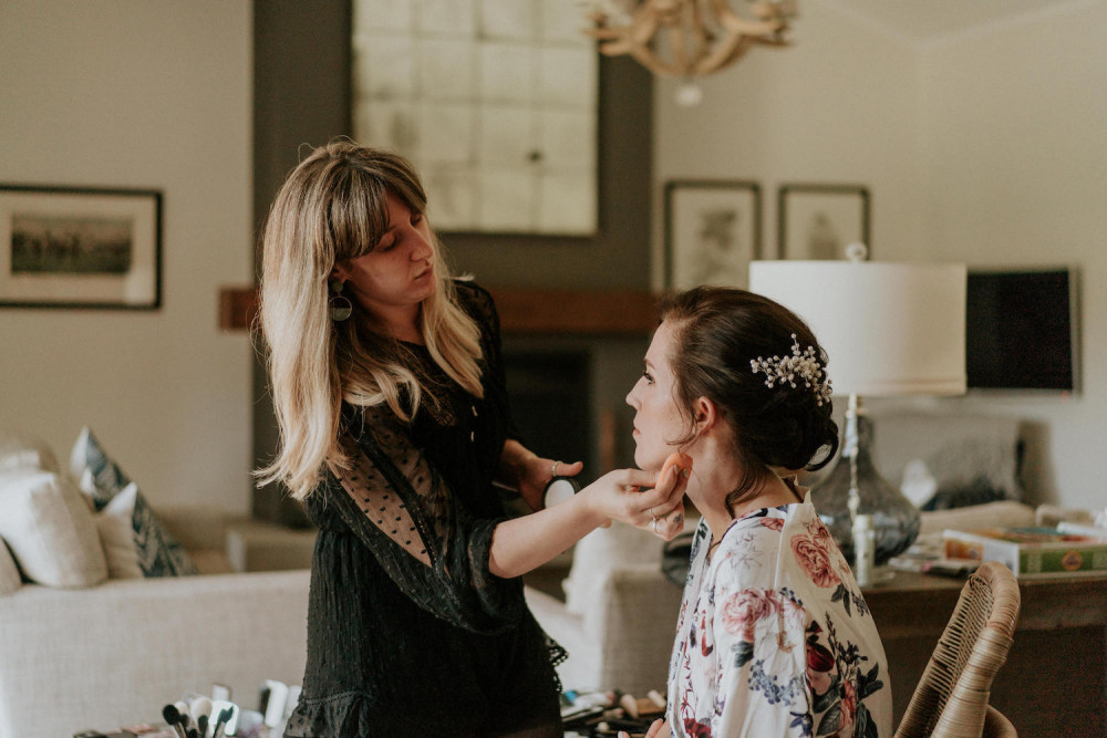 Quelle Bester doing Makeup on a bride.