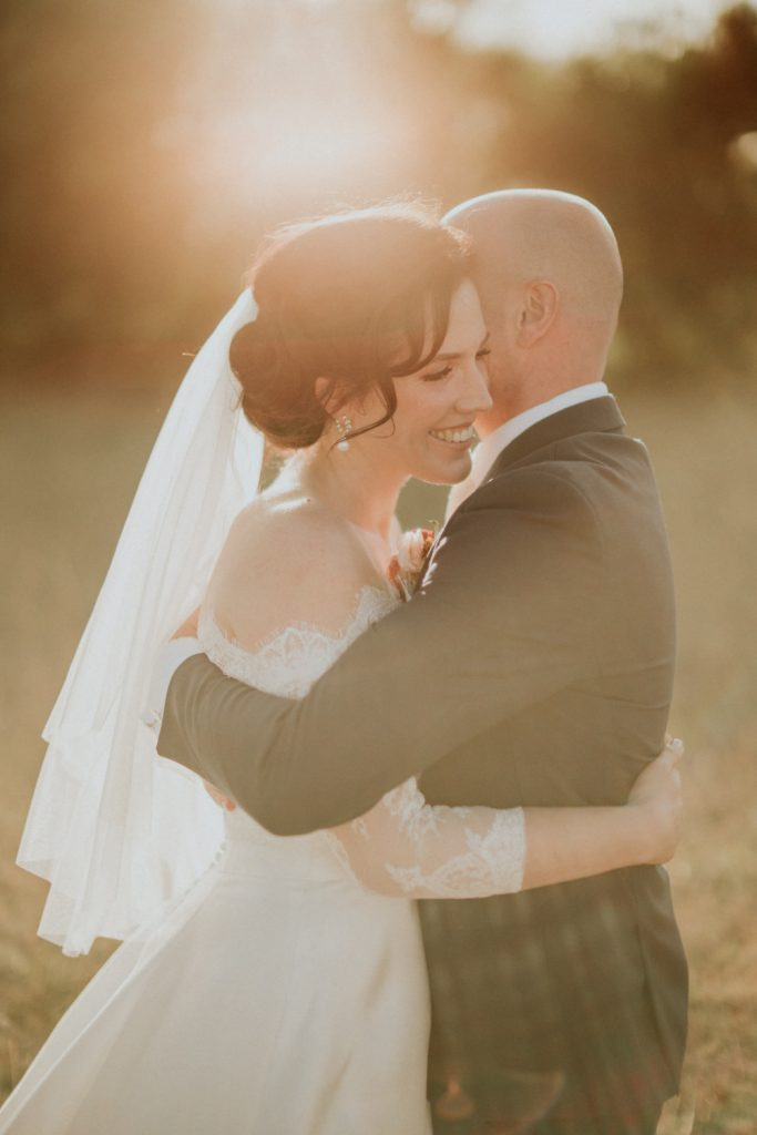 Romantic image of bride and groom on their wedding day