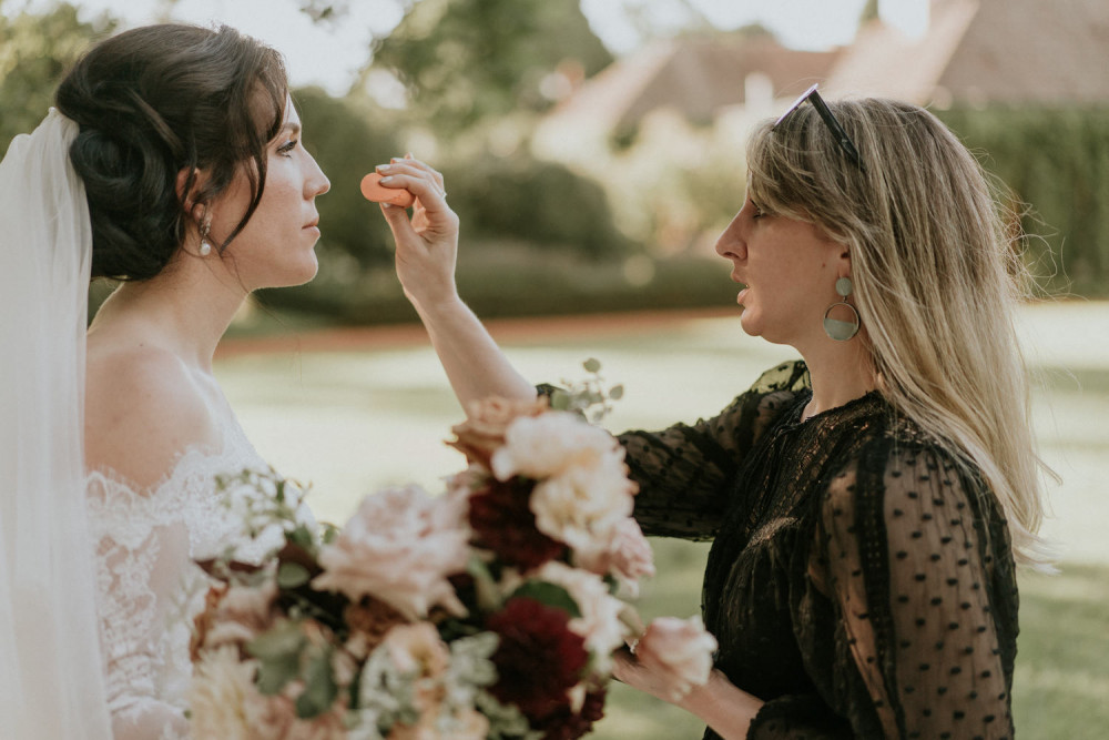 Quelle Bester, Makeup Artist adding makeup to a bride