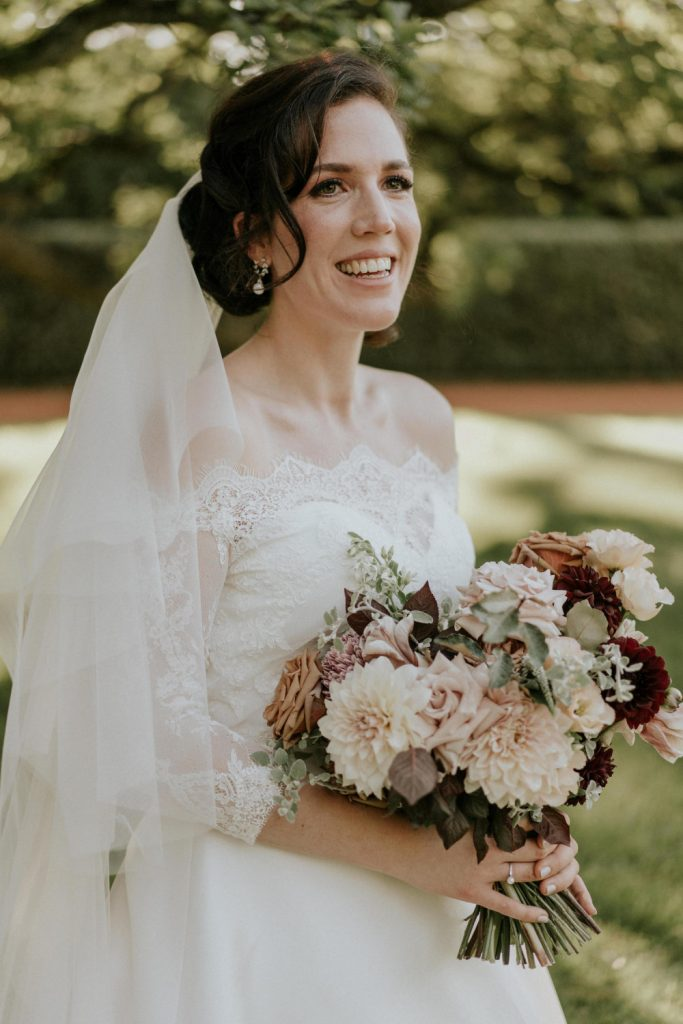 A beautiful bride with hsir and makeup by Quelle Bester