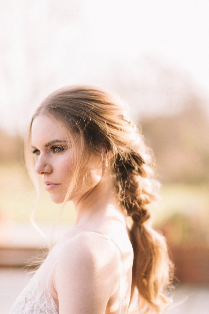 A dreamy bohemian bridal shoot with beautiful braided hairstyles and glimmering golden makeup by Hampshire hair and makeup artist Melissa Clare.