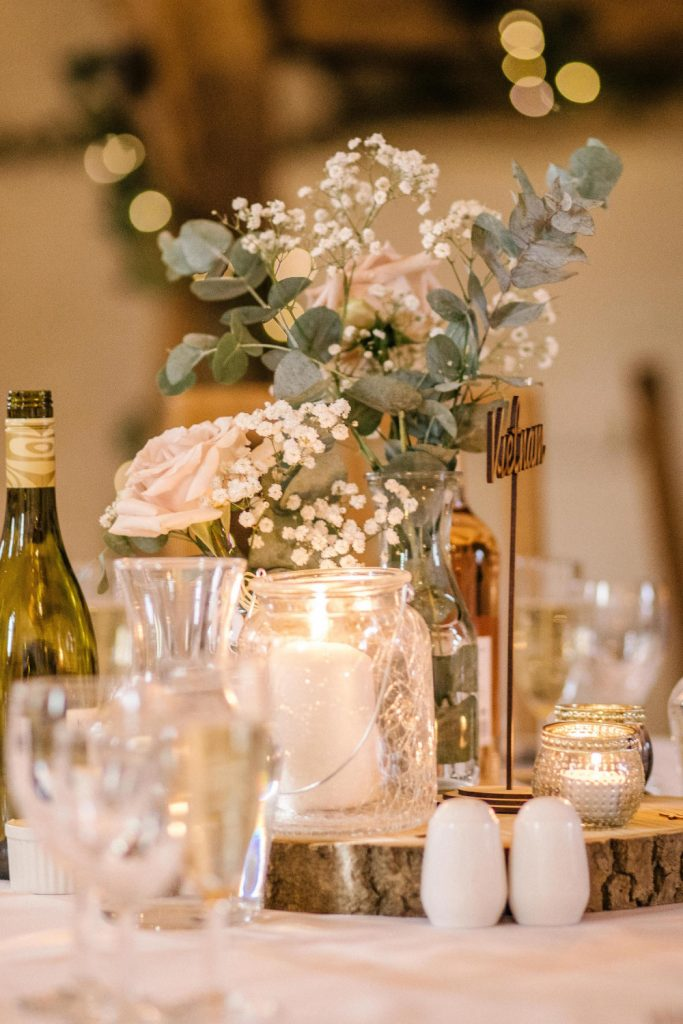 Wedding decorations, candles, gypsophila flowers and roses