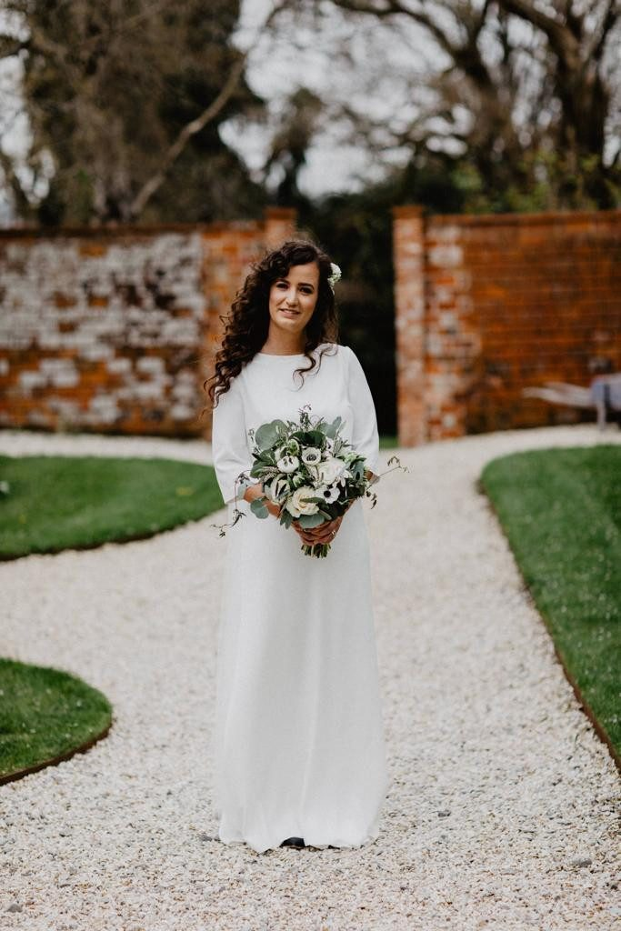 Beautiful bride with green and white bouquet