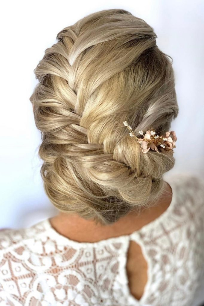 Blonde bridal hairstyle with chunky conche French plait