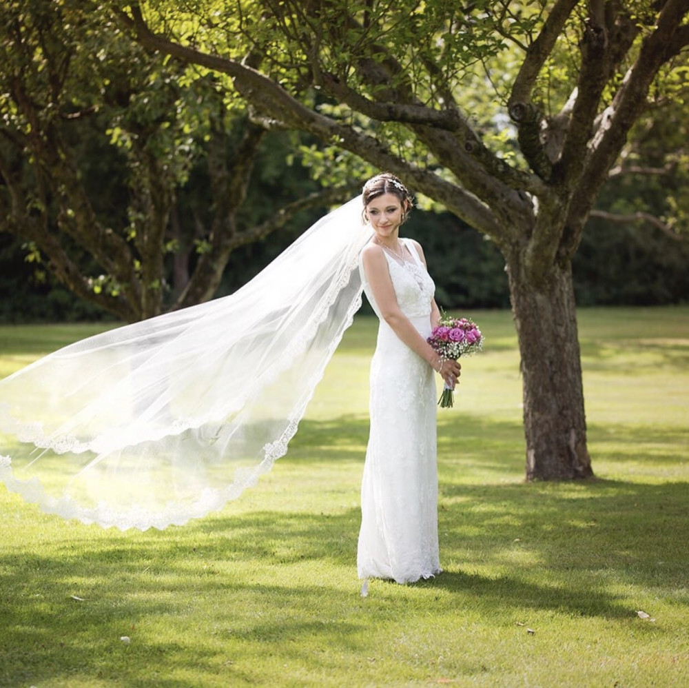 Beautiful bride wearing cathedral length veil. Makeup by Artist Leanne O'Neill Photography by Katie Ingram Dress and Veil by Tilly Trotters