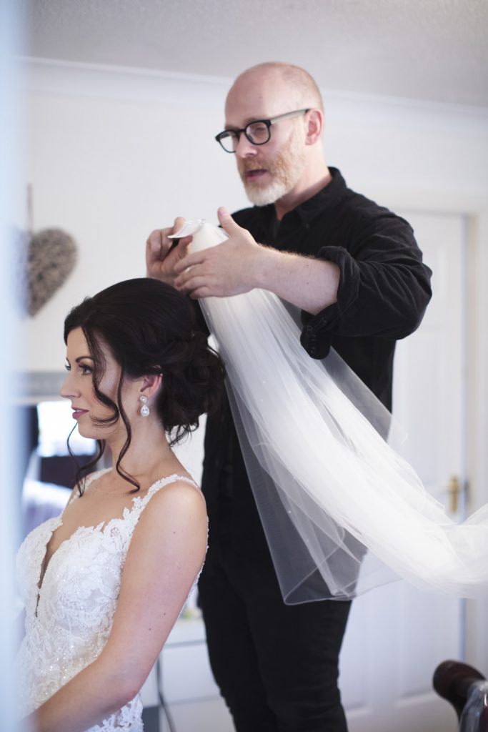 Bride having a beautiful hair style by Gavin Harvie. Photography by PJ Photography