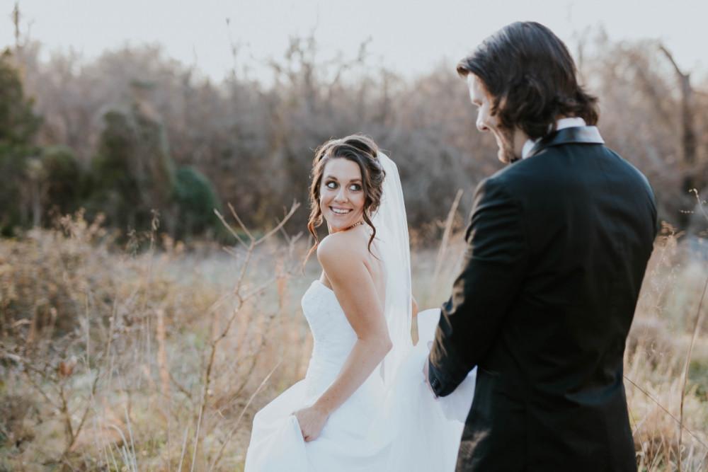 Beautiful bride wearing romantic veil over face