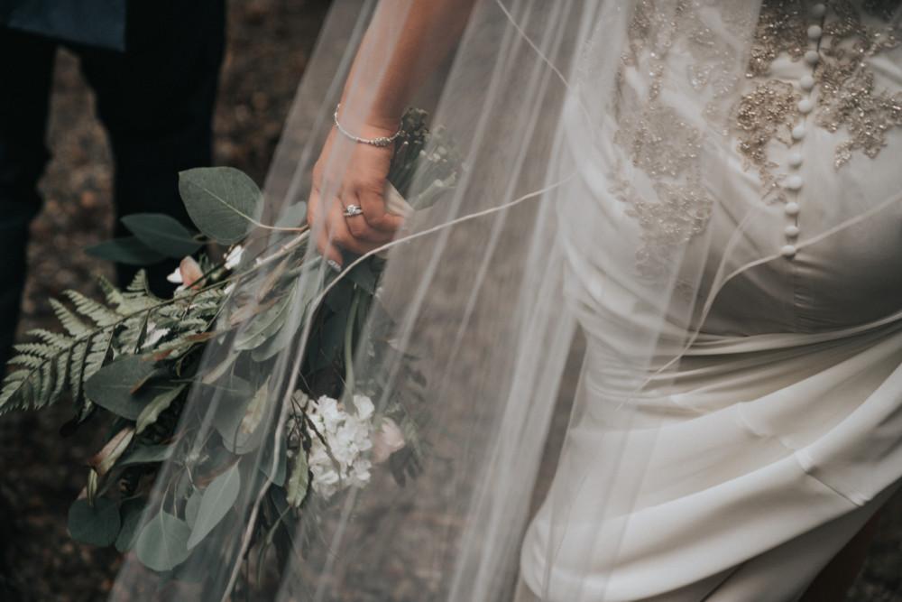 Beautiful bride wearing ballet length veil