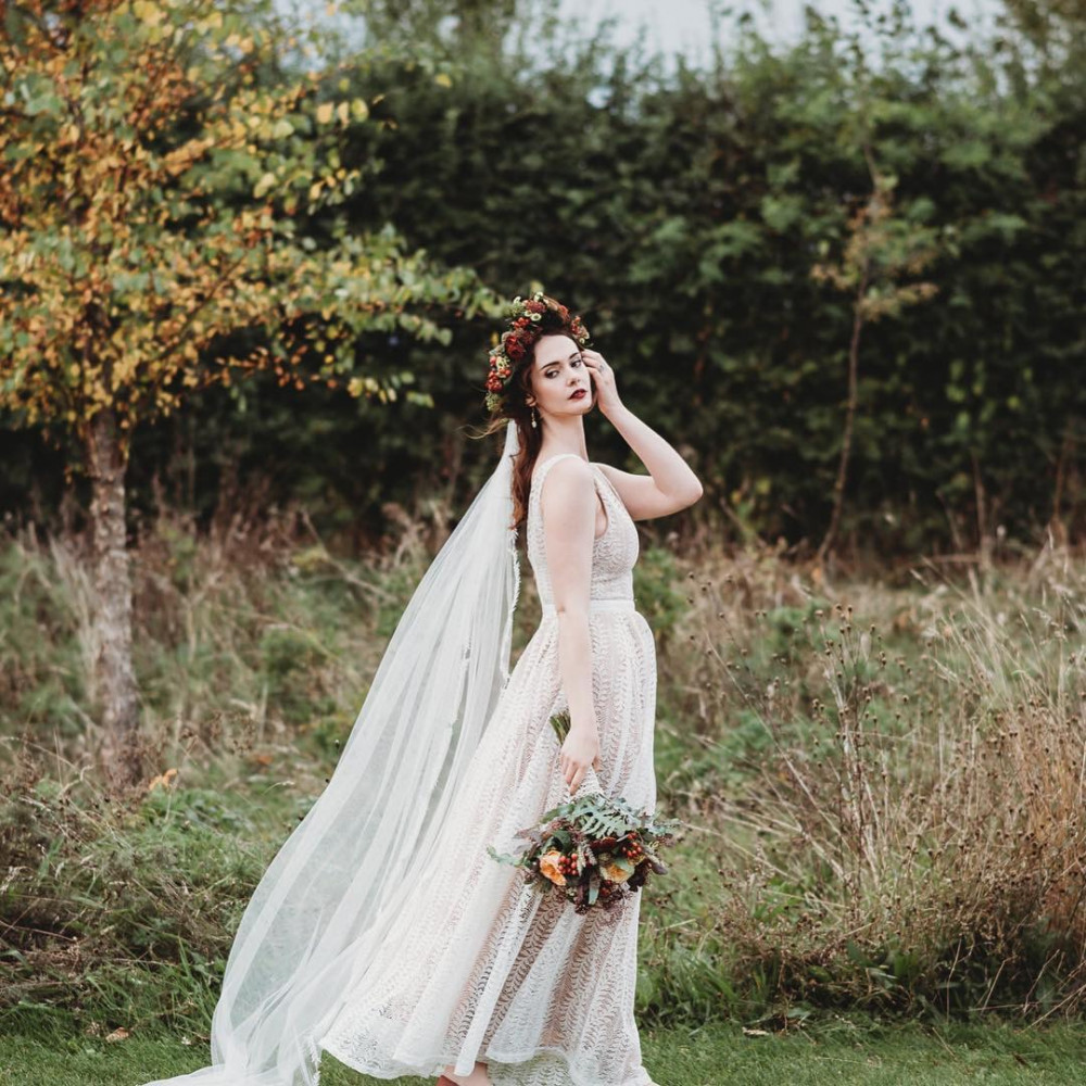 Beautiful bride wearing chapel length veil. Hair and makeup by Ellie Norman Makeup Photography by Eloise Nurse Veil by Eden B. Studio
