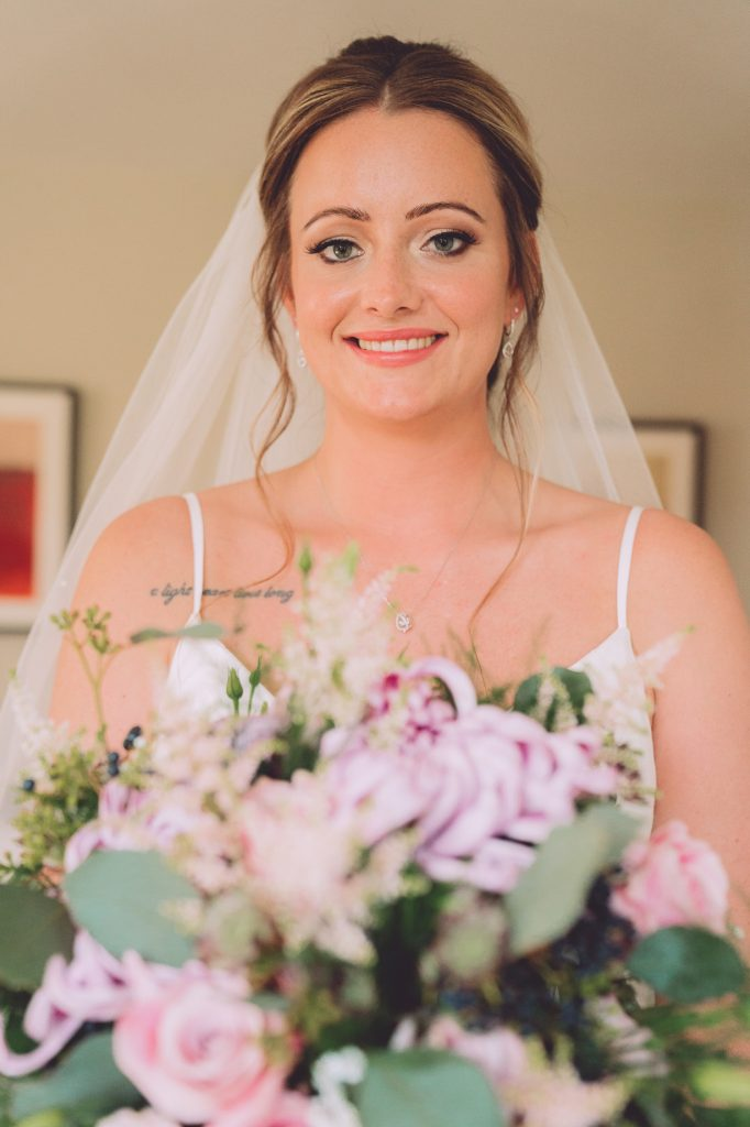 bride-with-pink-purple-bouquet