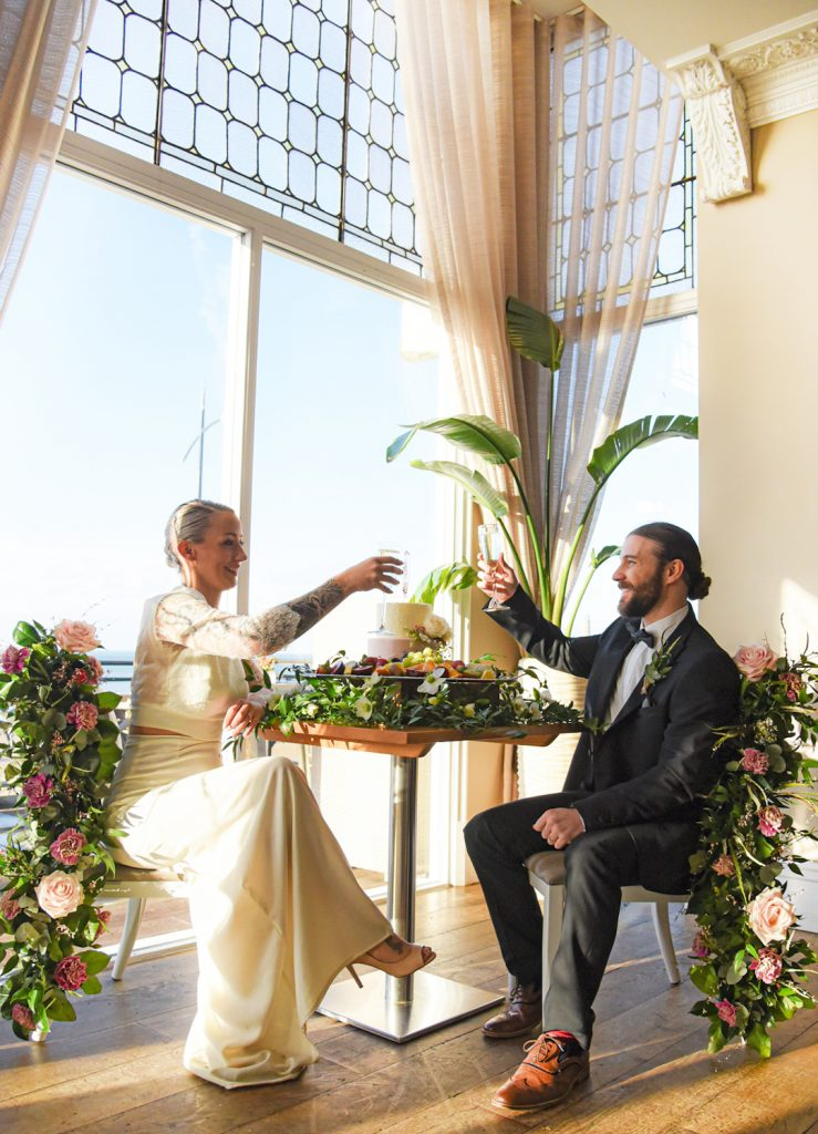 sands-hotel-couple-floral-table