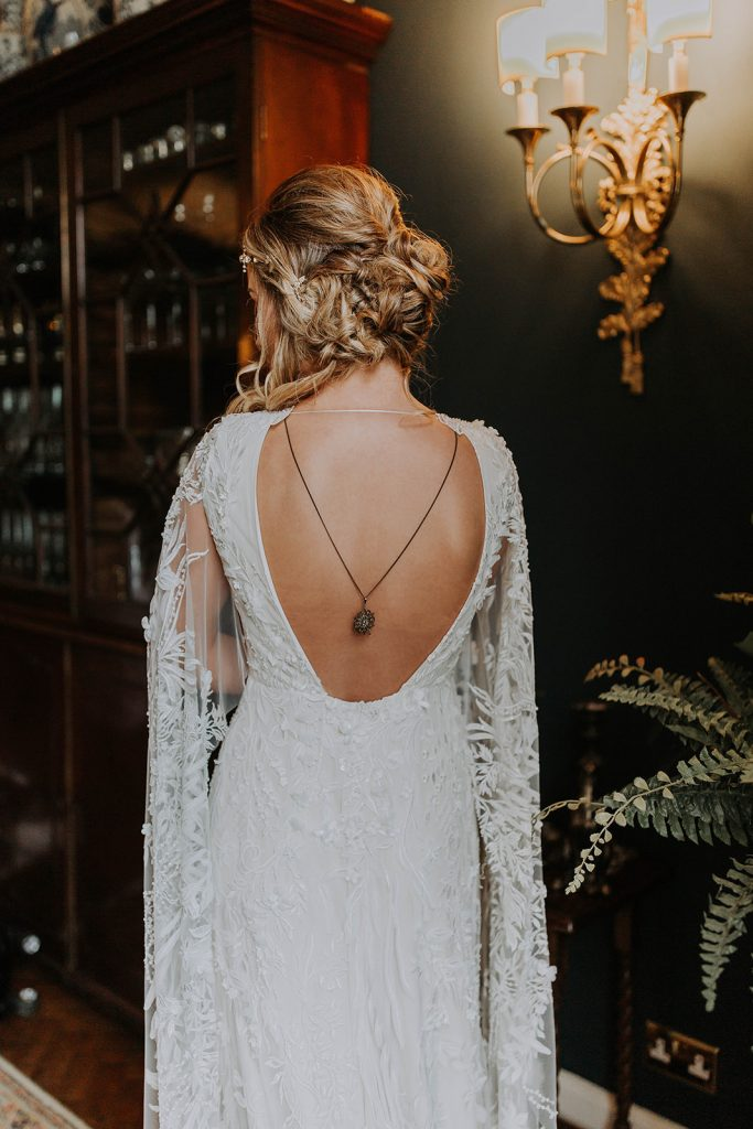 loose-updo-with-low-back-wedding-dress