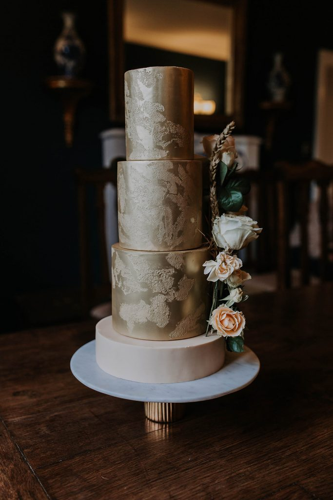 textured-gold-wedding-cake-with-fresh-flowers-and-corn-decorations