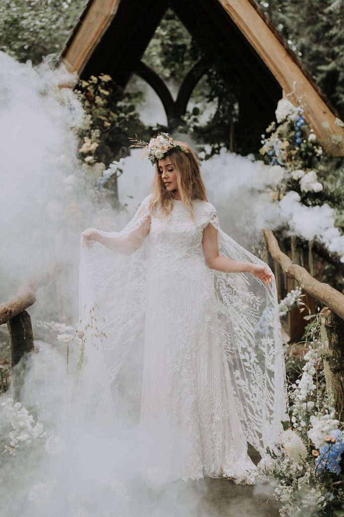 elegant-boho-forest-bride-in-lace-cape-dress