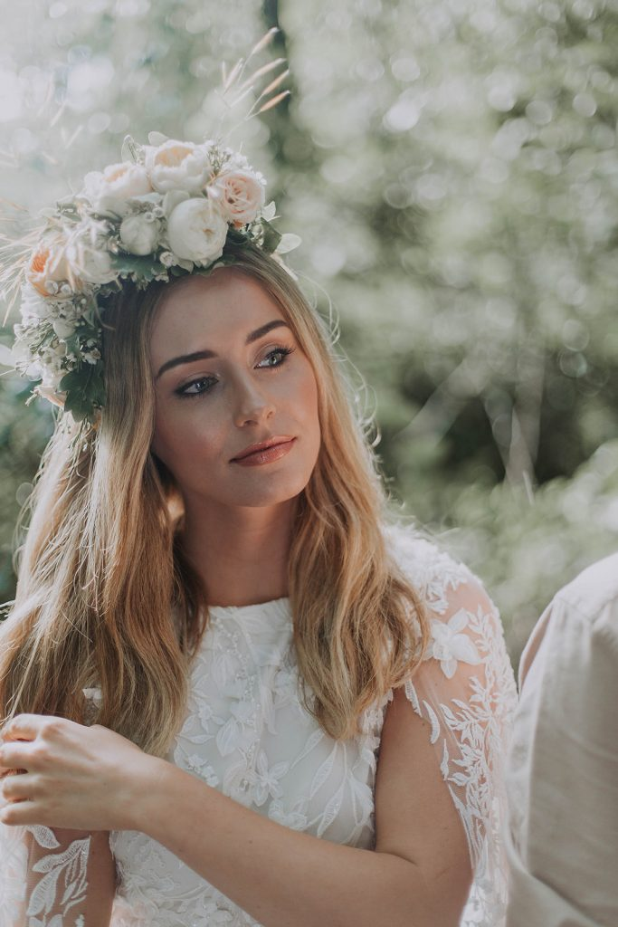 floral-crown-with-loose-waves-and-lace-wedding-dress