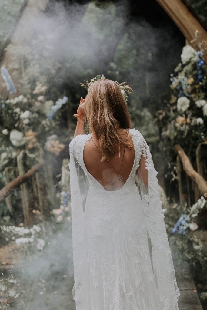 back-view-of-lace-wedding-dress-with-loose-waves