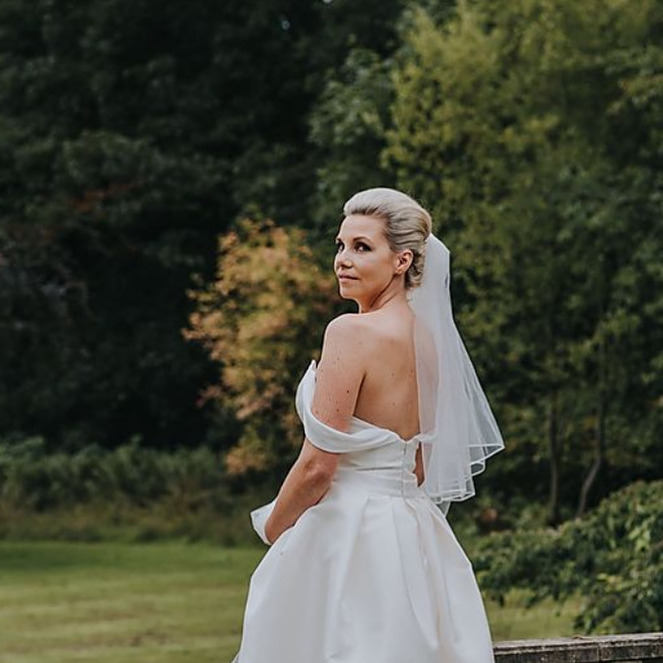 bride-in-off-shoulder-gown-with-short-veil