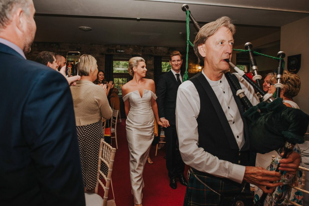 culcreuch-castle-wedding-reception-arrival-with-bagpipes
