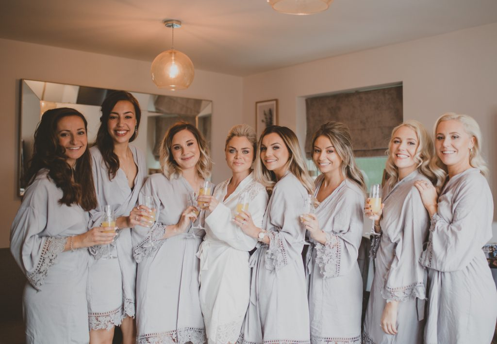 bride-with-bridesmaids-getting-ready