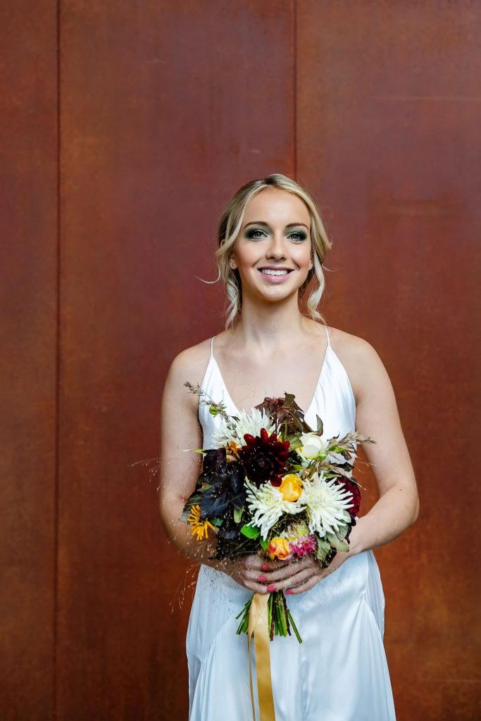 bride-with-bright-autumnal-bouquet