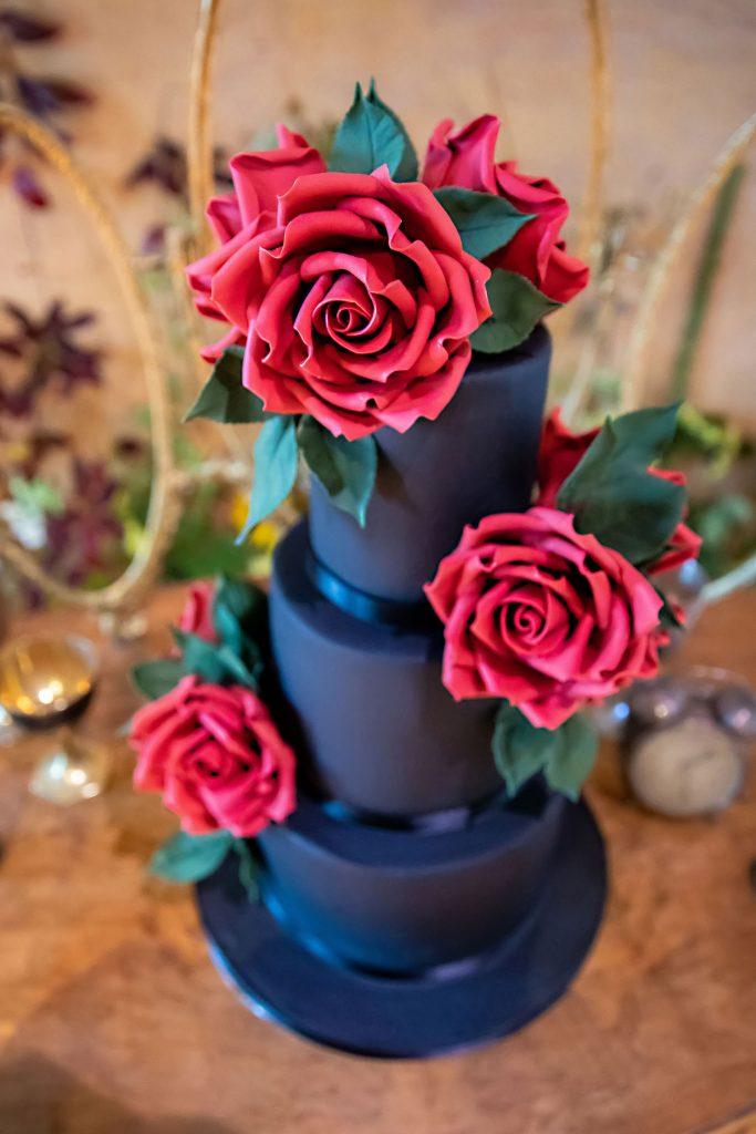 black-wedding-cake-with-pink-fondant-flowers