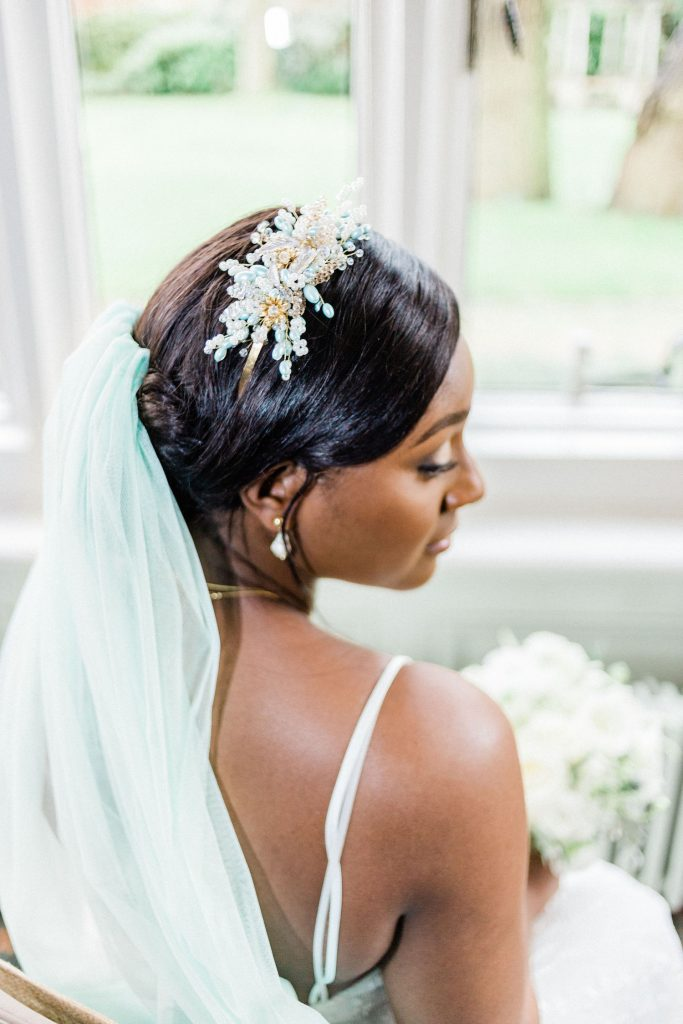 black-bridal-hair-with-mint-gold-embellishment