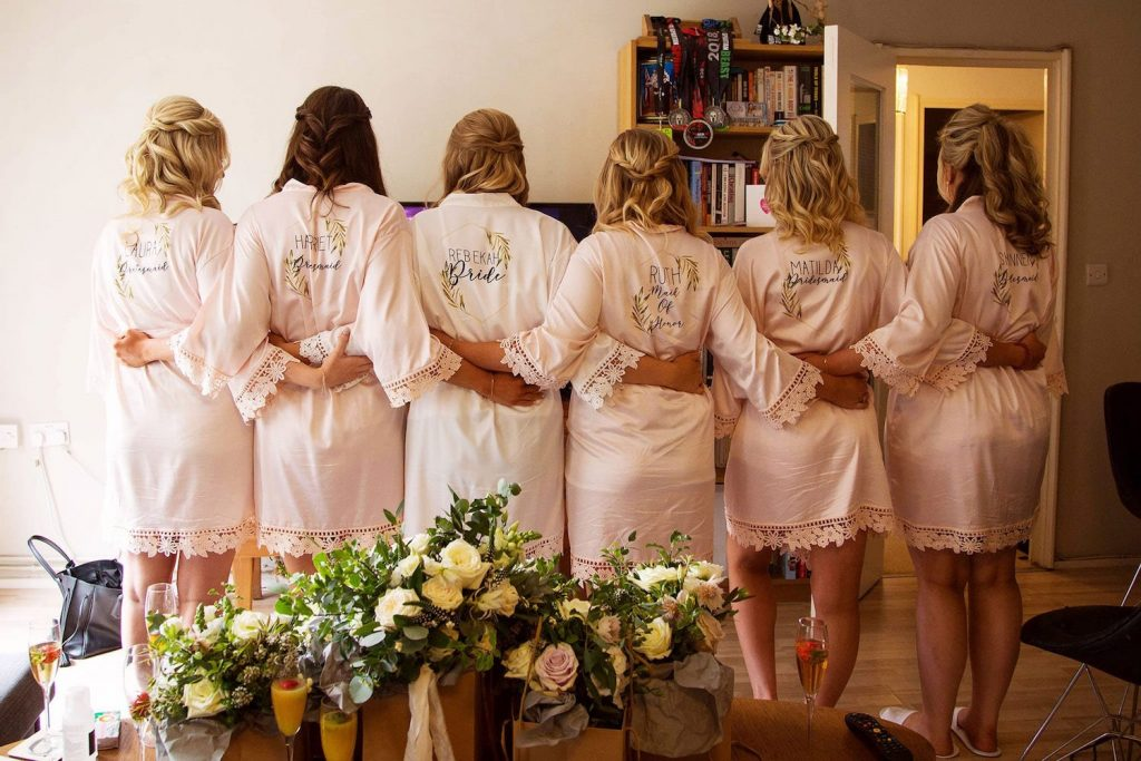 bridesmaids-in-custom-robes-with-half-up-half-down-waves