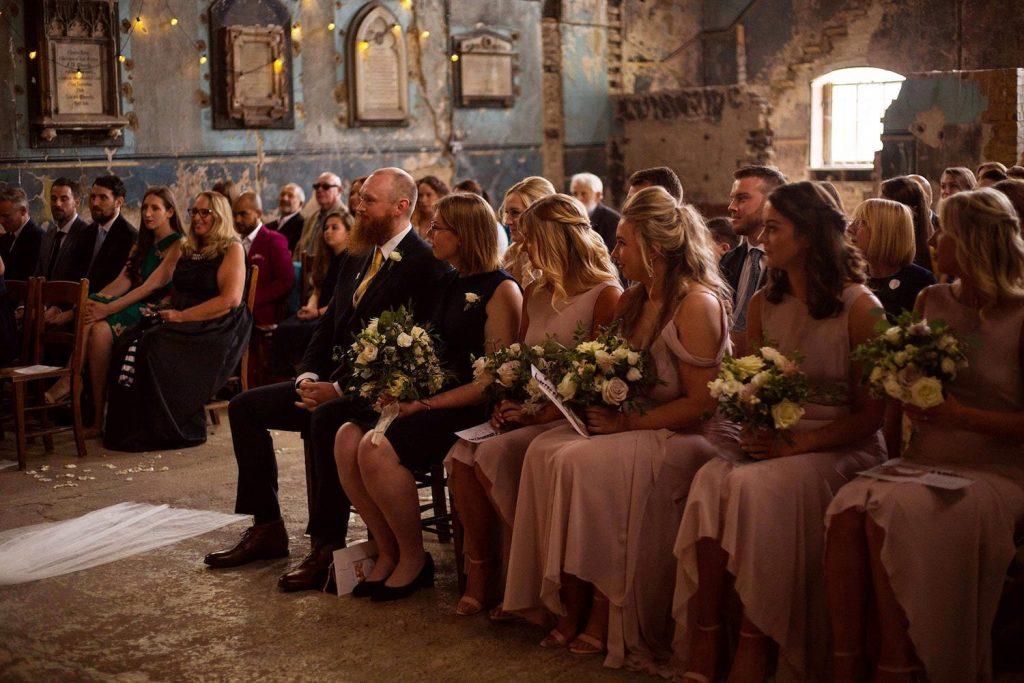 bridesmaids-in-rose-dresses-at-asylum-chapel-wedding