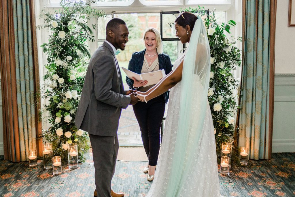 indoor-ceremony-with-floral-arch