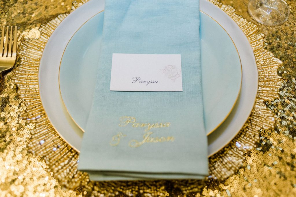 embroidered-mint-napkin-on-gold-sequin-linens