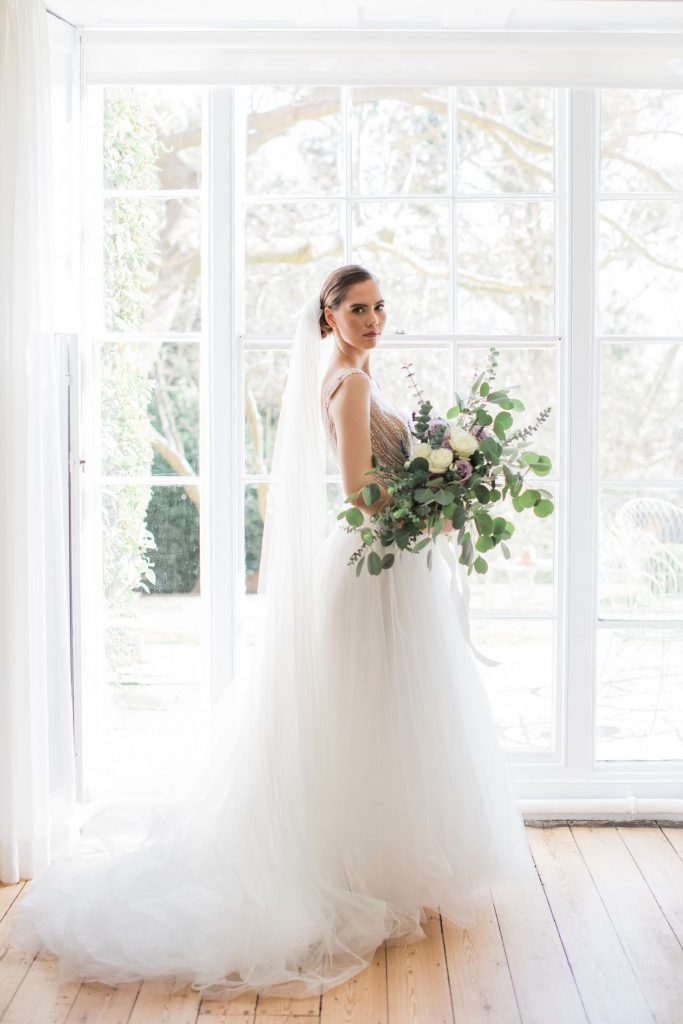 bride-in-maggie-sottero-with-loose-tied-bouquet