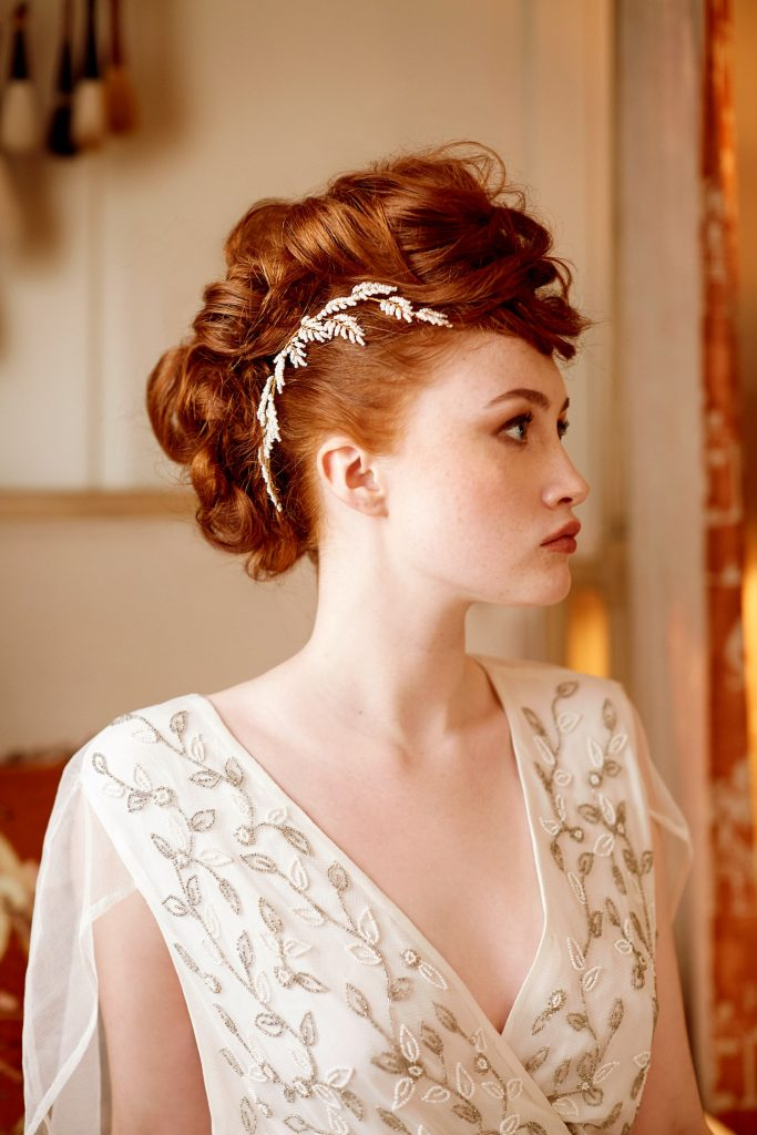 fauxhawk-bridal-updo-with-crystal-hair-accessories