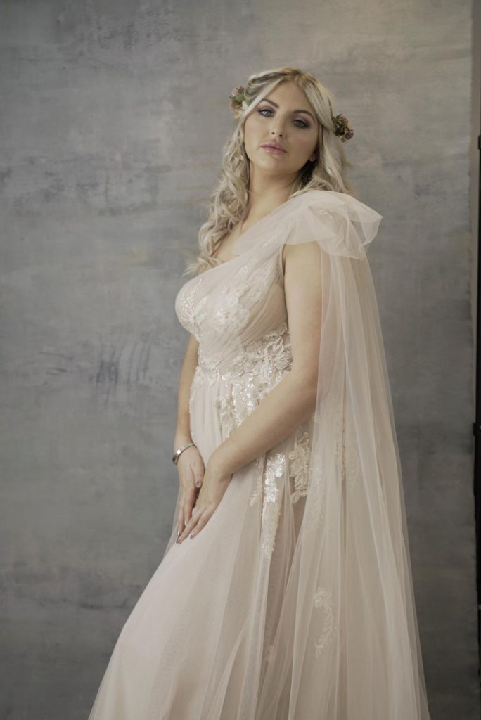 Grecian bride with lace detail and shoulder drape