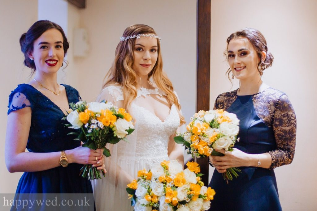 bride and bridesmaids yellow bouquets