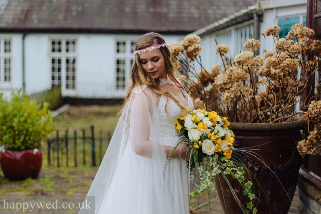 boho bride with cape
