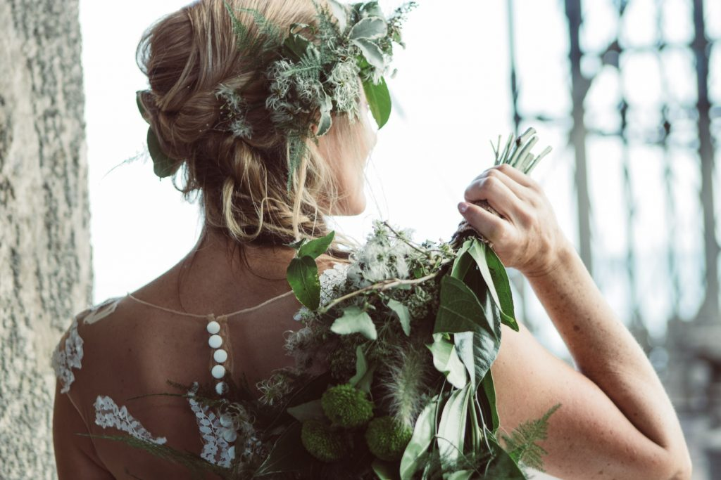 boho bride with greenery crown and bouquet