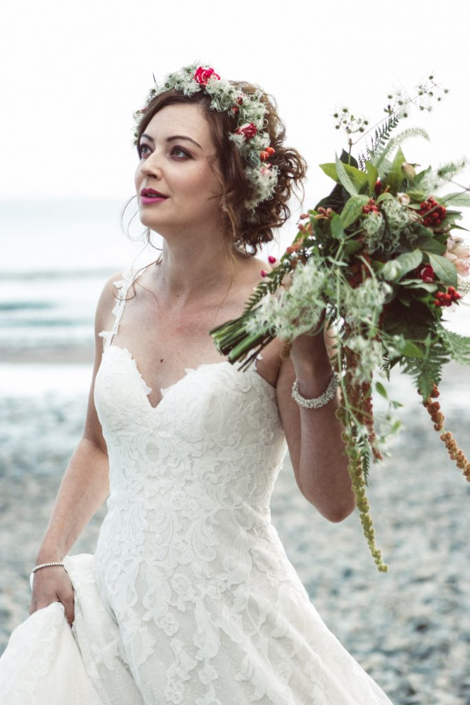 boho beach bride with soft updo