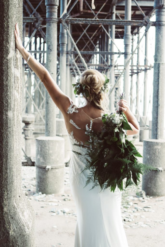 beach boho bride with greenery bouquet
