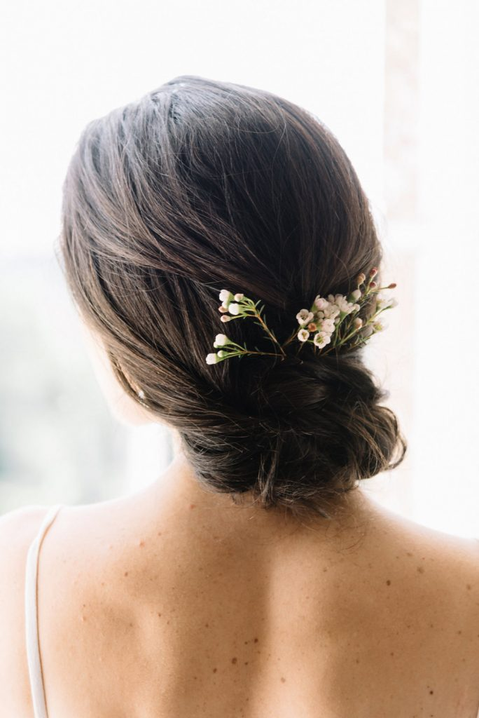 simple wedding hairstyle low loose bun