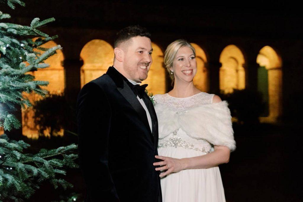 festive black tie wedding bride and groom