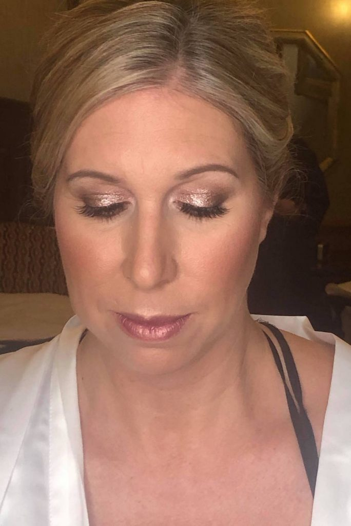 soft neutral winter bridal makeup with sparkle on the eyes