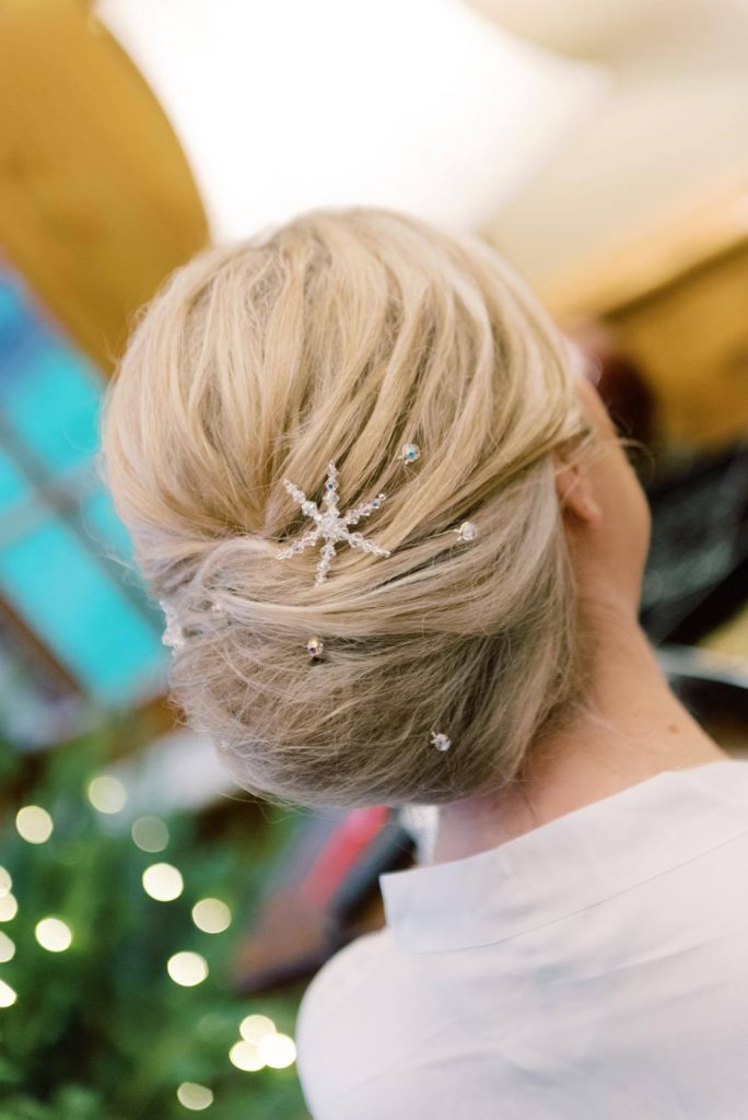 winter bridal updo with crystal snowflake and Swarovski pins