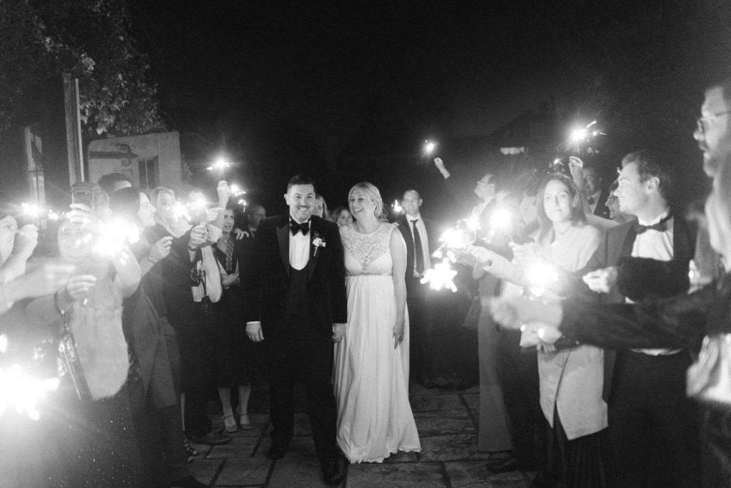 festive black tie wedding sparkler exit