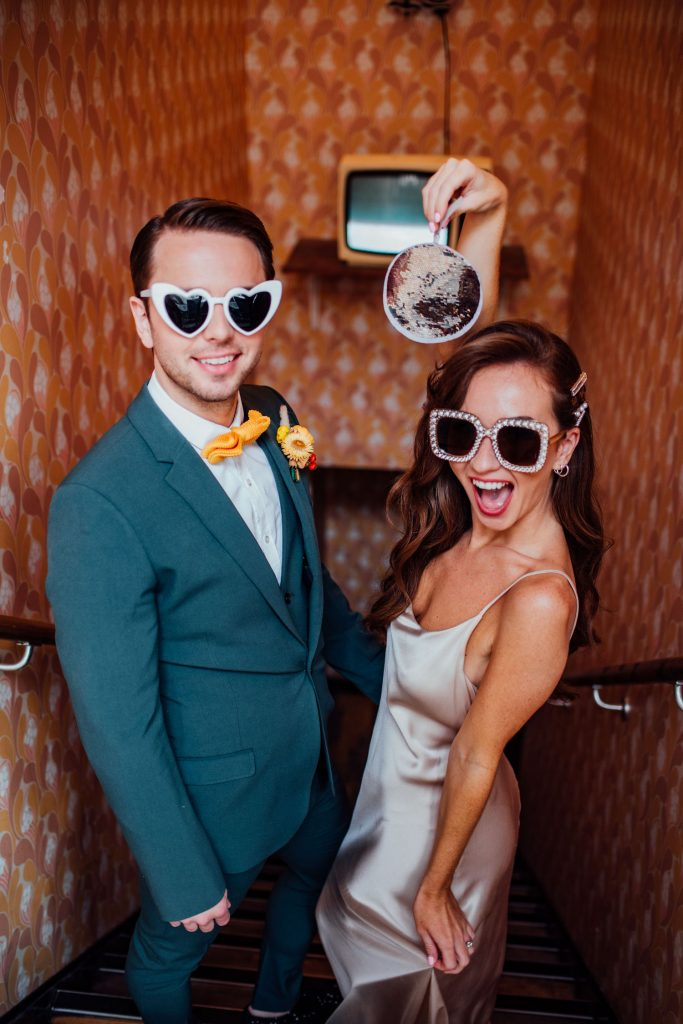 fun sunglasses for disco bride and groom