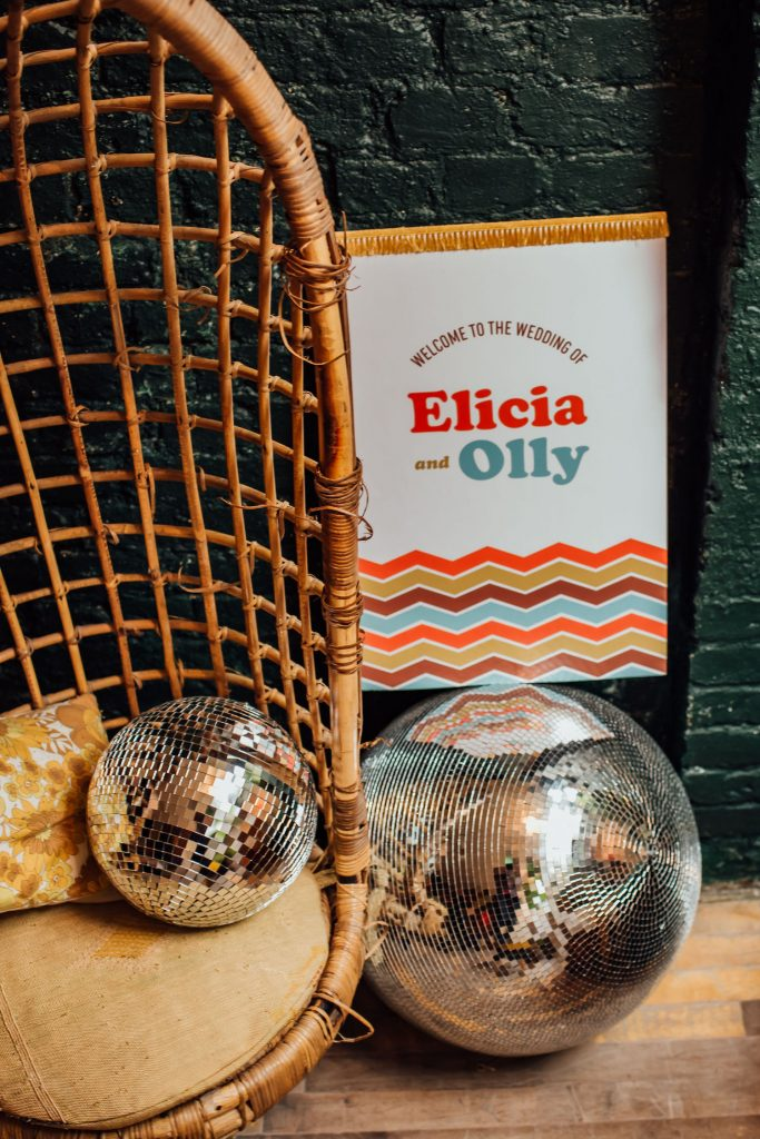 1970s wedding disco balls and signage