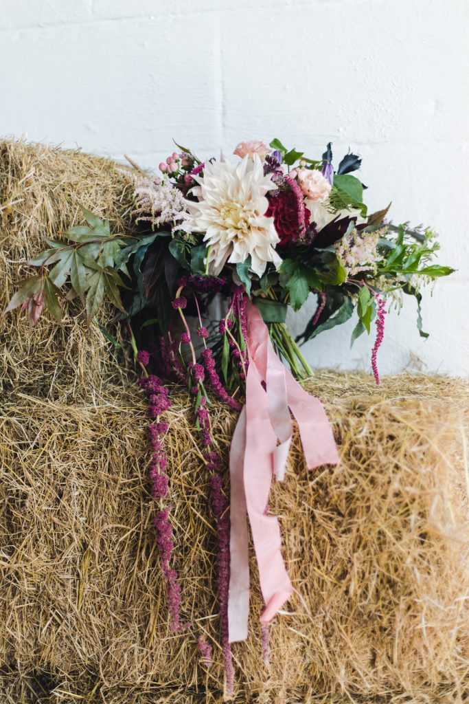 loose bridal bouquet with silk ribbon ties