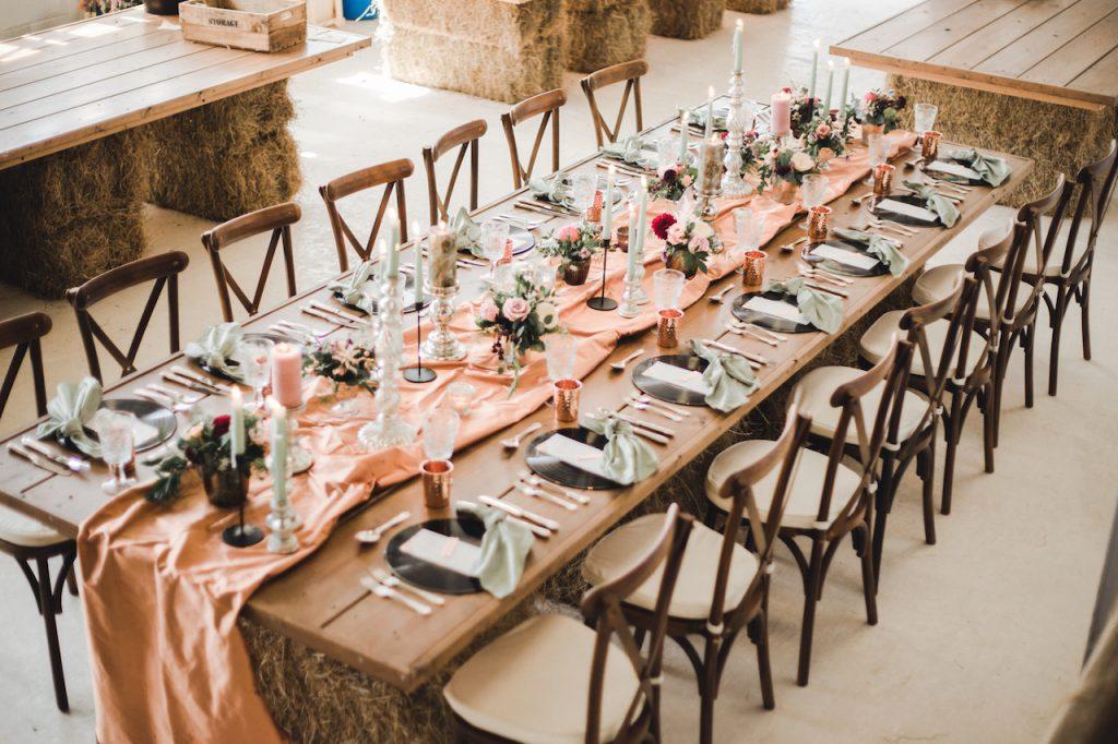 rustic meets bohemian luxe wedding table in barn venue