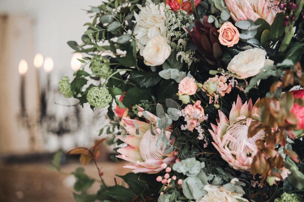 lush barn wedding florals with king proteas