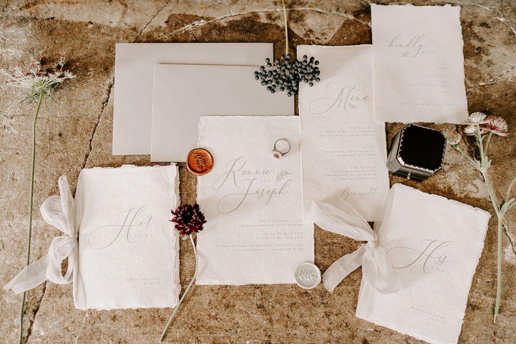 wedding invitation suite on handtorn paper
