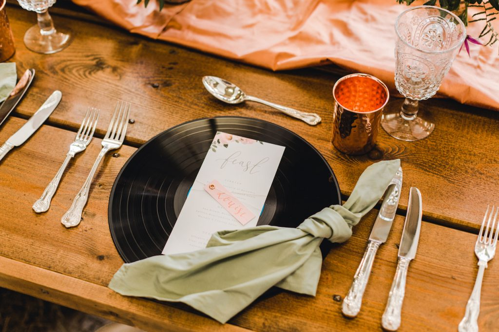 place setting with vinyl record charger